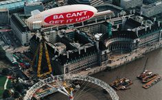 BA Can't get it Up. Virgin Airlines took a swipe at the late-running, British Airways sponsored Millennium Wheel project by flying a blimp over the site – carrying the message 'BA Can't Get It Up' Framed Prints, Canvas Prints, British Airways, National Photography, Stunts, Poster Size Prints, Photo Mugs, Photo Puzzle, Richard Branson