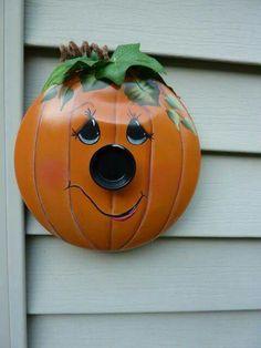 A old pot lid makes a cute pumpkin