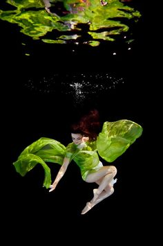 Ilse Moore photographed these models below the surface of water to have Joel Janse Van Vurren's dresses flow freely with the water. Gorgeous!