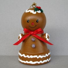 This sweet little Gingerbread Bell is all decked out with icing, gum drop buttons, a red bow, and holly berries. She is about 2 3/4 tall and made from a small clay flowerpot with a bell inside. She has a cord for hanging or can just sit on a shelf. All of my ornaments are original creations.  A great idea for a gift.  Thanks for checking out my shop. .