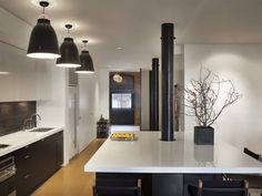 Designed by Dirk Denison Architects, this contemporary Tribeca apartment in New York City has a very clean design with elegant eclectic decor. Decor, Contemporary Kitchen, Kitchen Island Pillar, Tribeca Loft, Apartment Interior Design, Interior Design, Kitchen Style, Kitchen New York, Apartment Interior