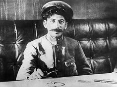 Joseph Stalin sitting at a table in 1918 - [[MORE]] namraka: Original caption: Joseph stalin sitting at a table in 1918. © SovfotoUIG