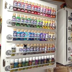 Paint organizing cabinet door - this is genius! So simple to do, and your paints are neatly lined up and all visible. MUST DO - best paint organization I've seen so far! (this would be so easy to do and perfect since I have cabinets to store my supplies)  #CraftStorage #CraftPaint #Crafts #DIY