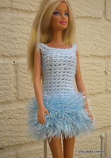 A simple crochet pattern using eyelash yarn and double knit. The eyelash yarn gives the dress a lovely fluffy appearance.