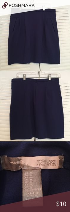 Forever 21 Navy Mini Skirt Forever 21 Navy Mini Skirt. Size Medium. Back zipper Forever 21 Skirts Mini