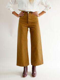 Jesse Kamm Sailor Pant - Tobacco  100% AMERICAN COTTON CANVAS IN TOBACCO. MADE IN CALIFORNIA.  $395 REGARDING FIT. THESE PANTS RUN SLIM IN THE HIPS. IF YOU HAVE A LARGER CABOOSE, AND ARE BETWEEN SIZES, WE SUGGEST GOING UP IN SIZE. A TAILOR CAN EASILY TAKE IN THE WAIST. YOU WANT THE TUSH TO FIT... NOT TOO TIGHT, BUT JUST RIGHT.