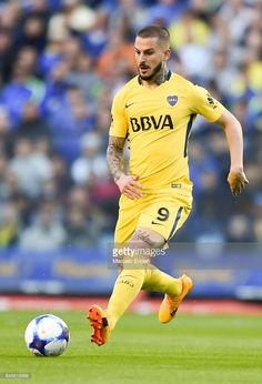 Dario Benedetto of Boca Juniors drives the ball during a match between Boca Juniors and Godoy Cruz as part of Superliga at Alberto J. Armando Stadium on September 2017 in Buenos Aires, Argentina. September 17, Soccer Players, People Like, Running, Pictures, About Football, Frases, Buenos Aires, T Shirts