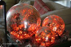 pottery barn mercury glass globes with orange halloween lights inside