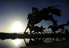 Runners clear the water jump in The Aquafield training Handicap Steeple Chase at Leicester racecourse on January 08, 2015 in Leicester, England. (January 7, 2015 - Source: Alan Crowhurst/Getty Images Europe)