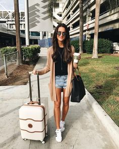 A great Sumer airplane outfit is some riped shorts a black plain shirt with a peach nude color