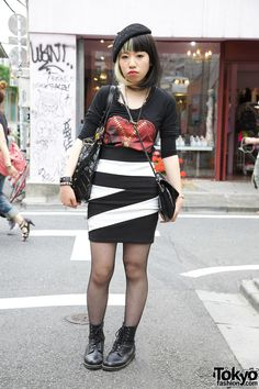 Girl with Cruella Deville hair, beret & ANAP skirt