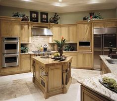 Fieldstone Cabinetry Glen Cove door style in Maple finished in Oregano with Chocolate glaze.