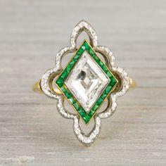 2.80 Carat Platinum on Gold Edwardian Diamond & Emerald Engagement Ring.  This truly remarkable vintage engagement ring is made in PLATINUM on gold and centered with an approximate 2.80 CARAT EGL certified fany cut diamond with I-J color and SI1 clarity. Center diamond is set in an EDWARDIAN setting accented by calibre cut emeralds and single cut diamonds. C 1910