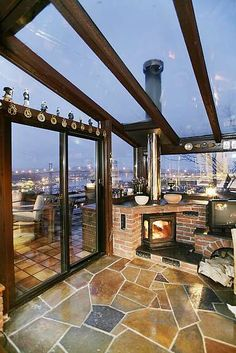 Glass, fireplace/stove, and terrace overlooking the city...