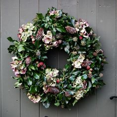 The hydrangea wreath is made up of hydrangea, artificialraspberries, pine cones, pine and tree ivy.