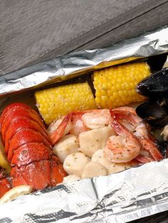 Ultimate Lobster Bake in one easy bag. Includes two lobster tails, a dozen mussels, eight shrimp, eight scallops and two ears of corn. Drenched in herbed lemon butter sauce Packaged in large foil bag to cook on the grill or in oven. Grilling Recipes, Seafood Recipes, Gourmet Recipes, Cooking Recipes, Healthy Recipes, Seafood Dishes, Lobster Bake, Lobster Tails, My Favorite Food