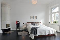 A simple white bedroom.