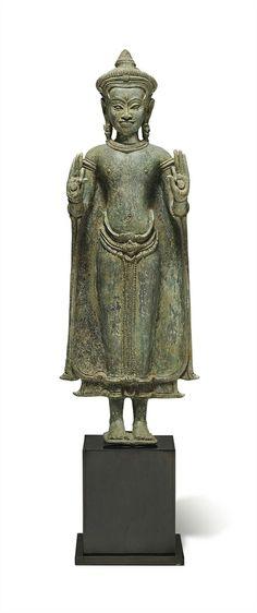 A bronze figure of Buddha. Khmer, Angkor period, 12th century