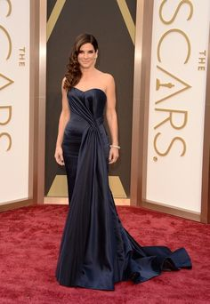 Sandra Bullock | Fashion On The 2014 Academy Awards Red Carpet - Understated, but lovely nonetheless. The draping on this is divine.