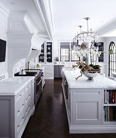 gorgeous white kitchens with dark flooring. We love the contrast!
