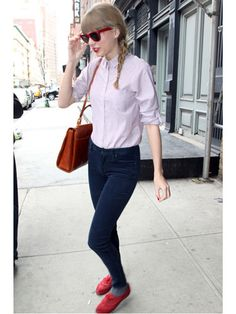 Light pink button up cardigan tucked into jeans with red shoes and sunglasses with a carmel brown purse