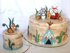 Woodland camping cake with fox and raccoon.