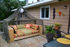 the outdoor daybed we built using a pallet as a base and a futon mattress wrapped up like Fort Knox with heavy gauge vinyl shower curtain liners and duct tape (beneath the pretty fabric exterior).   Totally weather proof - held up to Irene's flooding downpours on Sunday!