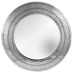 A detailed mosaic frames the Mera round wall mirror. Small hand-placed glass pieces are individually set around the silvered glass mirror. Variations in color and pattern reflect the artistic beauty of this mirror.