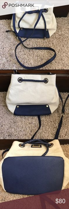 "Calvin Klein Drawstring Canvas Crossbody Bag 100% authentic  Smoke pet free home  Perfect condition no flaws clean inside and out  Drawstring Canvas and blue colors  Width 11"" Height 9.5"" Strap drop and adjustable 23"" Calvin Klein Bags Crossbody Bags"