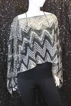 Beautiful scarf, that can be worn in several different ways! Completed with a unique pattern. One Size, 100% Polyester. Style SC-206