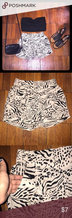 "H&M Animal Print Shorts These adorable shorts are a blush color with black animal print. Has side pockets and elastic waistband. Approximate flat measurements are 13"" waist and length from top to bottom 12 1/4"". H&M Shorts"