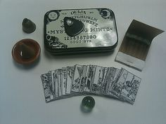 Miniature seance kit in an ouija board mint tin - crystal ball, tarot deck and all. Mint Tins, Altered Tins, Altered Books, Tin Art, Altoids Tins, Diy Couture, Tin Boxes, Book Of Shadows, Crystal Ball