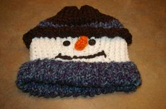 Made this snowman hat doing the loom knitting process