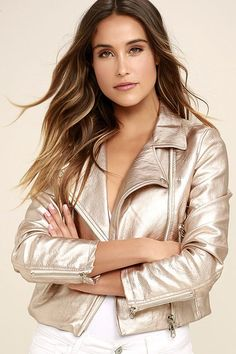 The One and Stun Rose Gold Vegan Leather Moto Jacket is all you need for a showstopping ensemble! Metallic vegan leather shapes this classic moto jacket with an array of zipper pockets across the fitted bodice, plus long sleeves with zipper cuffs. Collared neckline leads into an asymmetrical front zipper.