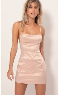 tyle: L50107 This edgy yet classy dress is the perfect year-round party dress. Features sexy side boob cut outs, princess seams and a flattering shape.  Made in our luxurious light blush pink stretch satin. Take this dress to a mimosa brunch or a night out in town. Pair with your favorite leather jacket or knee-high boots. Party on!     - Made In Los Angeles