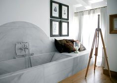 Marble tub, bench, and arched backsplash; Hotel La Malcontenta
