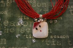 Handcrafted Holiday Christmas Santa Fused Glass With Necklace. $22.00, via Etsy.