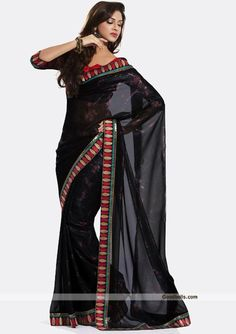 Elegant pattern gorgeous black saree designed with floral prints. Contrast patch work gives it rich look. Perfect selection for kitty and evening parties. http://goodbells.com/saree/gorgeous-black-saree.html
