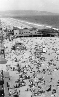 "Hermosa Beach, a postcardPostcard view of Hermosa Beach which reads, ""The Strand at Hermosa Beach, California, looking toward Redondo Beach and the Palos Verdes Hills."" Postmark on postcard: August 28, 1950."