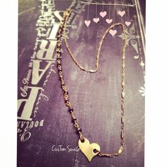 A personal favorite from my Etsy shop https://www.etsy.com/listing/219085981/gold-heart-initial-stone-choker