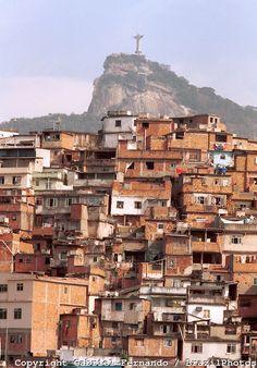 Morro da Coroa ( Coroa slum ) at Santa Teresa quarter, Rio de Janeiro favela, Brazil. Christ the Redeemer and Corcovado in the background.