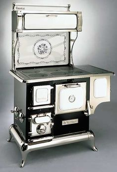 Heartland Sweet Heart Cookstove, Shown with optional Water Reservoir and Williamsburg Splashback Motif.