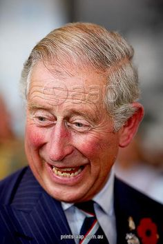 Print:  HRH The Prince of Wales laughs during a meeting with Australian Defence Force personnel and their families at Garden Island in Sydney (also available in other products)