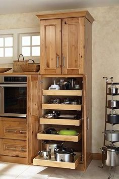 Smart kitchen organization ideas with the roll out tray cabinet is the smart way to store your pots, pans, and small appliances. It provides a hassle free access with simple arrangement.
