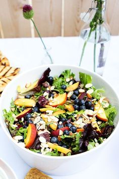 Summer salad with blueberries, peaches, slivered almonds and mixed greens with a raspberry vinaigrette  {Two Peas and their Pod}