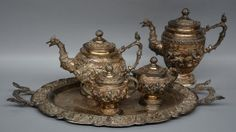 Lot 661: A silver coffee and tea set with rich relief decoration, Myanmar (Burma), H 13,5 > 23 - W 57 - D 36,5 cm - Total weight silver: ca. 4900 g  € 1.000 - € 1.500