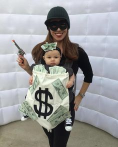 Scroll to observe some of our favourite family Halloween costume ideas. It's not among the simplest DIY Halloween costumes out there, but it's definitely Robber Halloween Costume, Baby First Halloween Costume, Baby Girl Halloween Costumes, Creative Halloween Costumes, Bank Robber Costume, Cute Baby Girl Costumes, Funny Halloween, Baby Carrier Costume, Primer Halloween