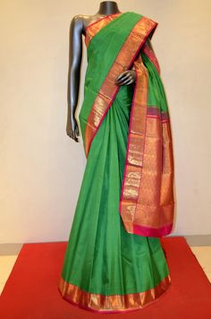 Parrot Green Traditional Kanjeevaram Silk Saree Product Code: AB210815 Online Shopping: http://www.janardhanasilk.com/index.php?route=product/product&search=AB210815&description=true&product_id=3949