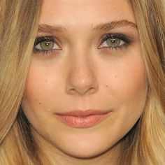 Elizabeth Olsen's flawless face- peachy pink lips with lightly smoked eyes.