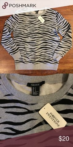 Animal print pullover sweatshirt This is super cute and new with tags! Size small Forever 21 Sweaters